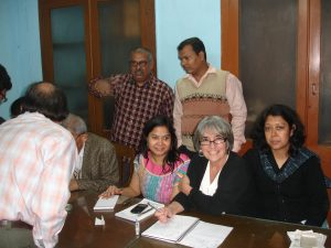 Joette Calabrese with Homeopathic doctors at the PBHRF Free night chambers (clinic) in Kolkata